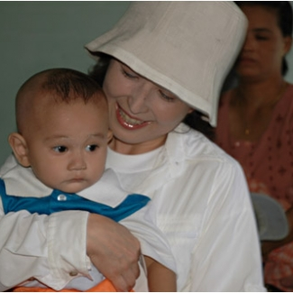 With a baby who came here for a vaccination. His hairstyle is so Myanmarese!